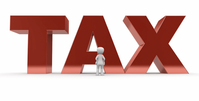 Image of TAX words in red