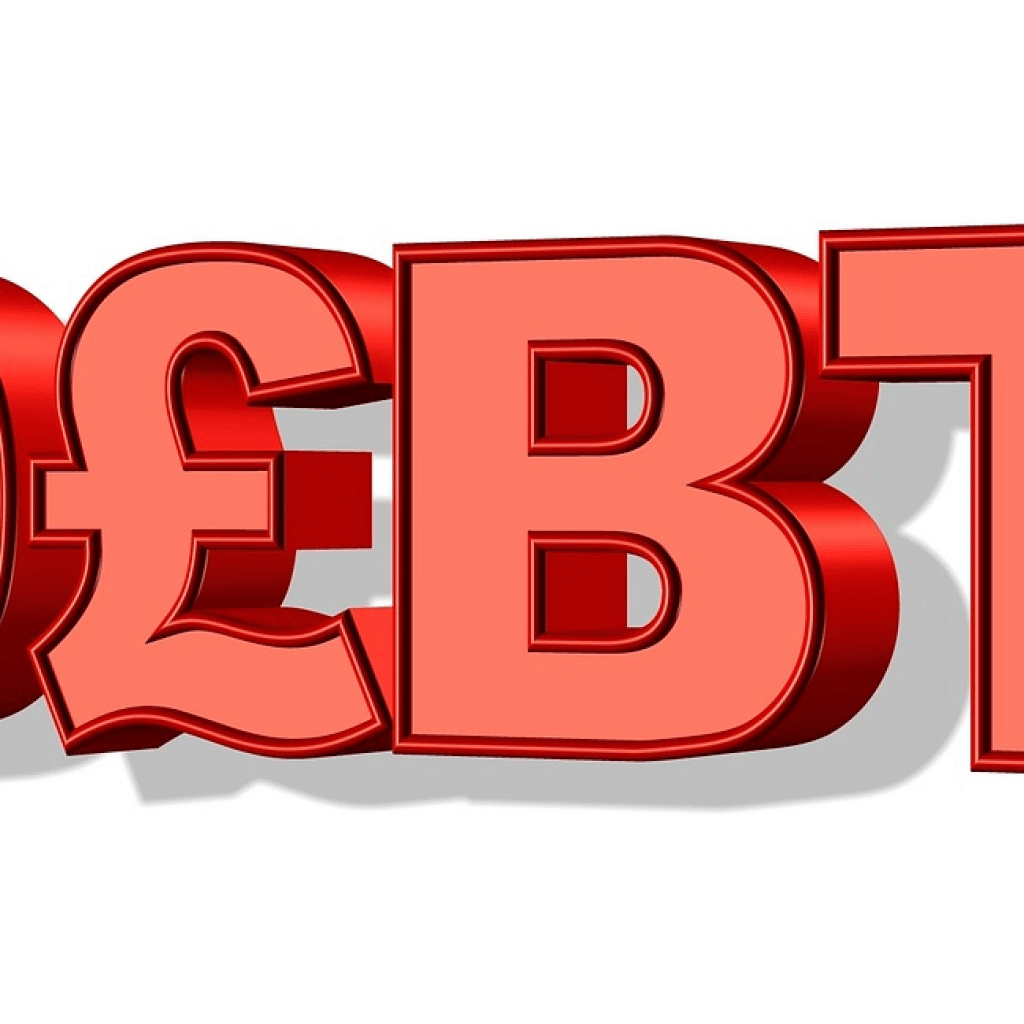 debt words in red, IRS tax settlement
