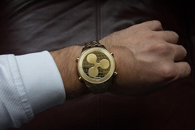 Picture of a wristwatch with the Ripple icon to accompany a blog post about a Ripple class action